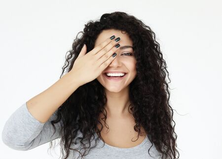 Photo for lifestyle, emotion and people concept - young woman covering her eyes with her hands over white background - Royalty Free Image