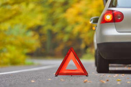 Foto de Broken car concept, breakdown triangle on road - Imagen libre de derechos