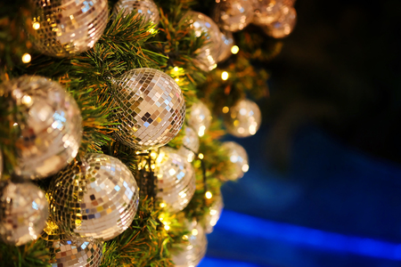 Foto de close up mirror ball or Christmas ball to decorative for Christmas festival with bokeh background. Have some space for write wording - Imagen libre de derechos