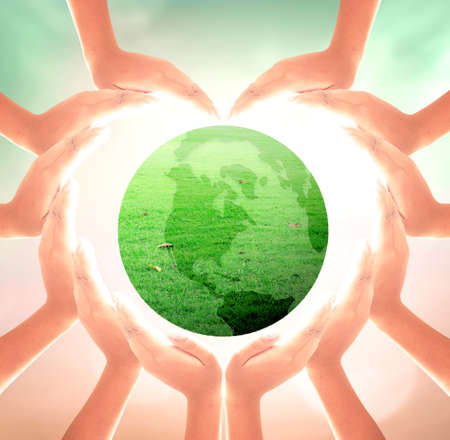 Photo pour World environment day concept: Heart shape of hands holding earth globe of grass over blurred nature background - image libre de droit
