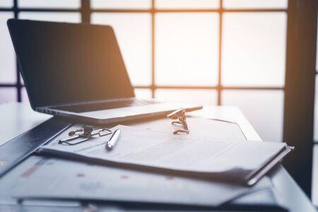 Photo pour Business desktop with laptop, glasses, business schedule - image libre de droit