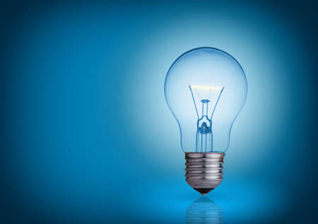 Photo for light bulb on blue background  - Royalty Free Image