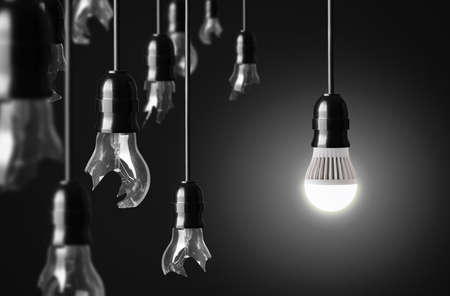 Photo pour idea concept with broken bulbs and one LED glowing bulb - image libre de droit
