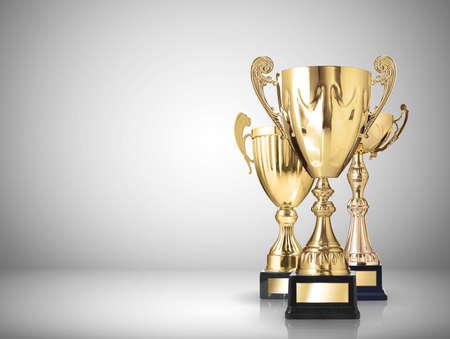 Foto de golden trophies on gray background - Imagen libre de derechos