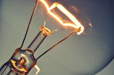 Photo pour Close up glowing light bulb - image libre de droit