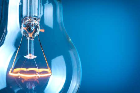 Foto de Close up glowing light bulb  - Imagen libre de derechos