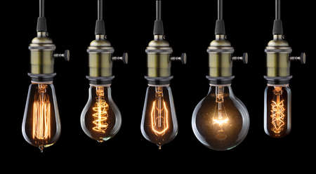 Foto de Set of vintage glowing light bulbs on black - Imagen libre de derechos