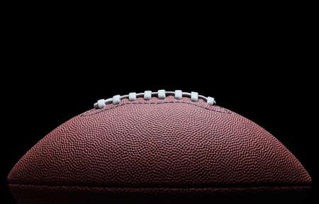 Photo pour American football over black background - image libre de droit