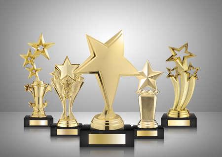 Photo pour gold star trophies on gray background - image libre de droit