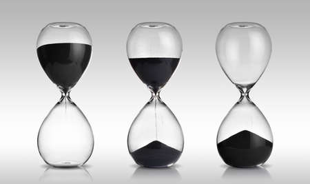 Foto de hourglass set on gray background - Imagen libre de derechos