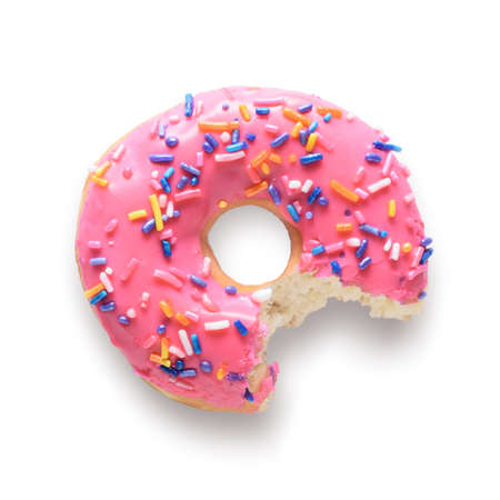 Photo for Pink frosted donut with colorful sprinkles with bite missing. Isolated on white background and include clipping path - Royalty Free Image