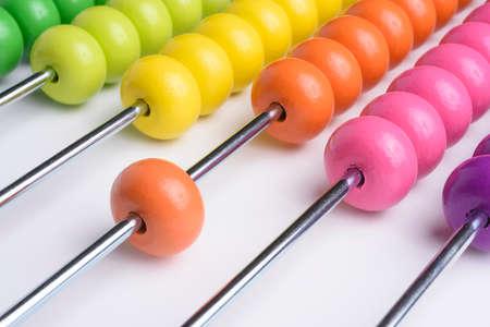 Foto de Close up wooden abacus on white background - Imagen libre de derechos