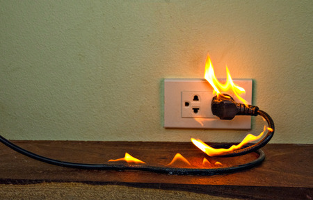 Photo pour On fire electric wire plug Receptacle wall partition,Electric short circuit failure resulting in electricity wire burnt - image libre de droit