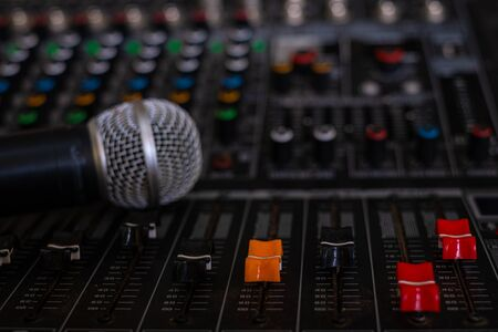 Photo for Microphone and audio sound mixer analog at the sound control room on blurred background - Royalty Free Image