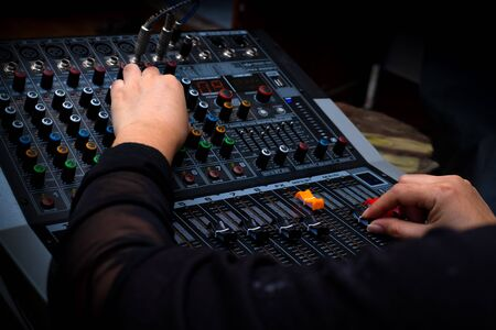 Photo for Woman hands mixing audio by sound mixer analog in the recording studio - Royalty Free Image