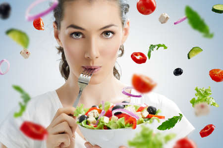 Foto de A beautiful girl eating healthy food - Imagen libre de derechos