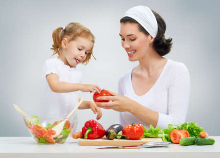 Photo for mother and daughter prepare salads - Royalty Free Image