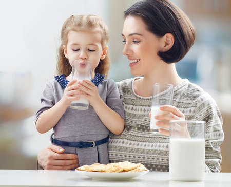 Photo for girl drinking milk at the kitchen - Royalty Free Image