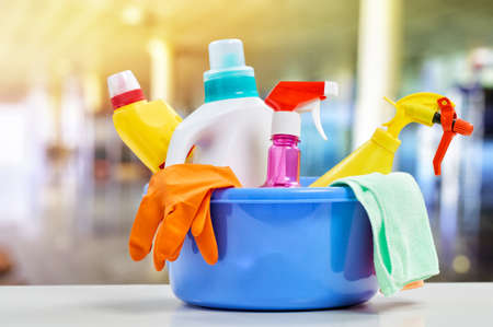 Foto de Basket with cleaning items on blurry background - Imagen libre de derechos