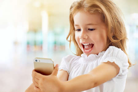 Photo for a beauty child taking selfie - Royalty Free Image