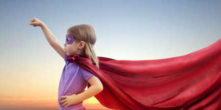 Photo pour a little girl plays superhero - image libre de droit