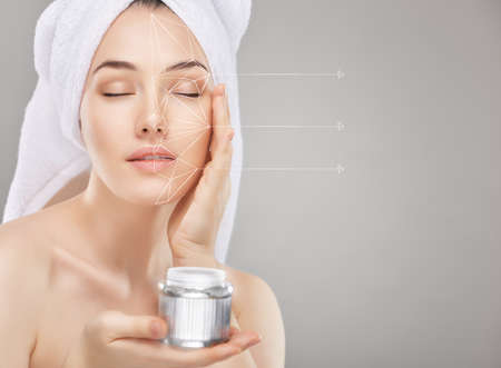 Foto de beautiful woman applying cosmetic cream - Imagen libre de derechos