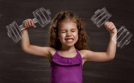 Photo pour beauty child at the blackboard - image libre de droit