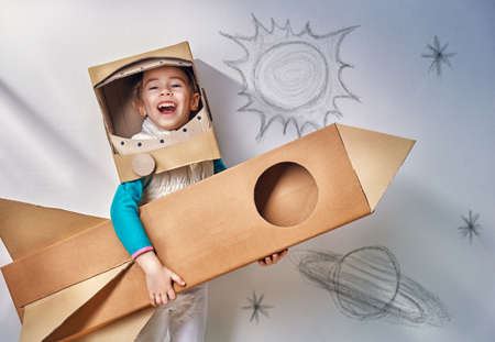 Photo pour child is dressed in an astronaut costume - image libre de droit
