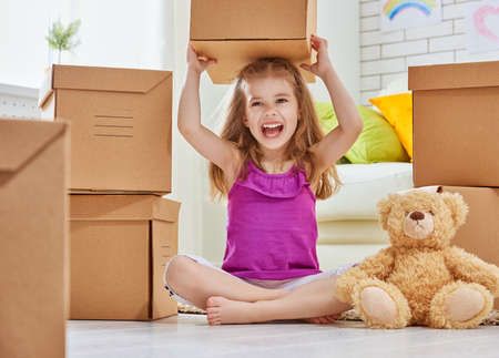 Photo for Happy girl move to a new home - Royalty Free Image