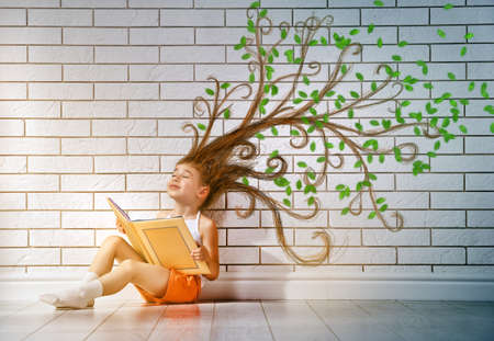 Photo for small beautiful child reading a book - Royalty Free Image