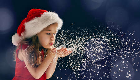 Foto de winter time! Happy little girl blowing on snow - Imagen libre de derechos