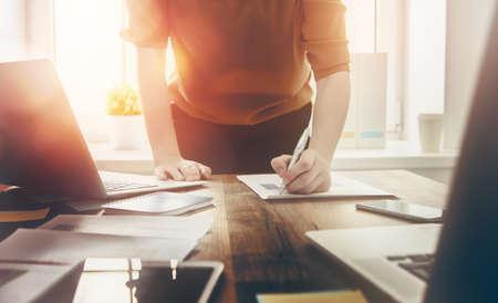 Photo pour Close up business woman signing documents. - image libre de droit
