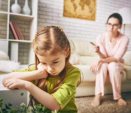 Foto de the education of the child. mother scolds her child girl. family relationships - Imagen libre de derechos
