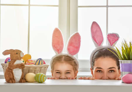 Photo for Happy easter! Mother and daughter begin to hunt for Easter eggs. Happy family preparing for Easter. Cute little child girl wearing bunny ears on Easter day. - Royalty Free Image