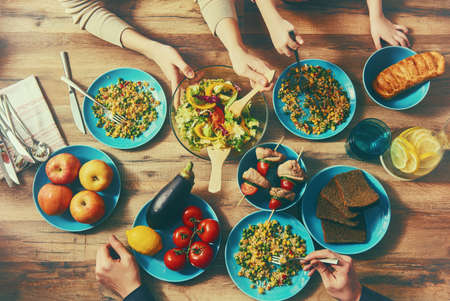 Photo pour Top view of family having dinner together sitting at the rustic wooden table. Enjoying  family dinner together. - image libre de droit