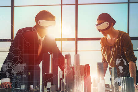 Foto de two business persons are developing a project using virtual reality goggles. the concept of technologies of the future - Imagen libre de derechos