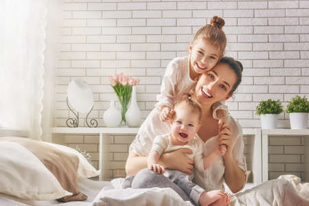Foto für Happy loving family. Mother and her daughters children girls playing and hugging. - Lizenzfreies Bild