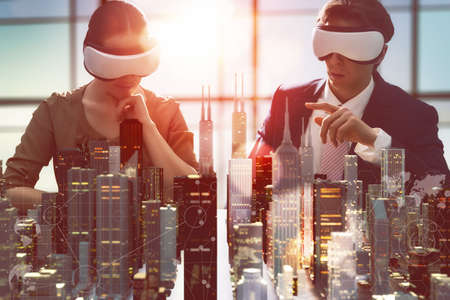 Photo pour two business persons are developing a project using virtual reality goggles. the concept of technologies of the future - image libre de droit