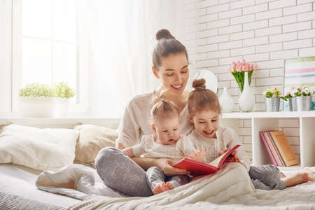 Foto für happy loving family. pretty young mother reading a book to her daughters - Lizenzfreies Bild