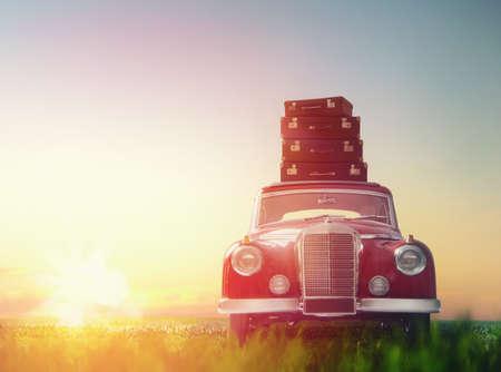 Foto de Toward adventure! The suitcases are on the roof of a vintage car. - Imagen libre de derechos
