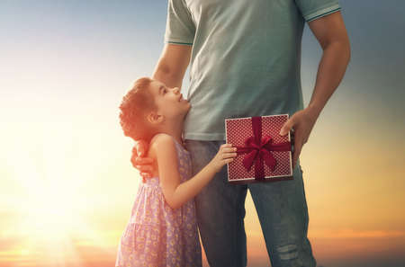 Photo for Happy loving family and Father's Day. Father and his daughter. Cute child girl gives a gift to dad. - Royalty Free Image