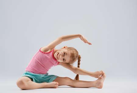 Photo for Cute little child girl enjoying yoga. - Royalty Free Image
