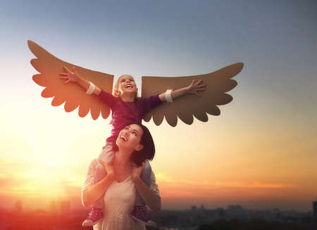 Photo pour Mother and her daughter child playing together. Little girl plays in the bird. Happy loving family having fun. - image libre de droit