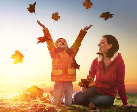 Photo pour Mother and her child girl playing together on autumn walk in nature outdoors. Happy loving family having fun. - image libre de droit