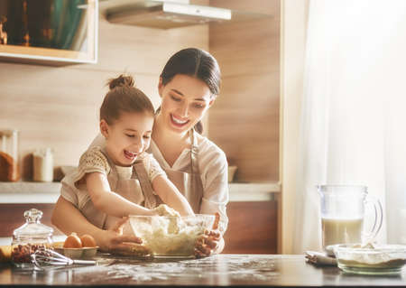 Photo pour Happy loving family are preparing bakery together Mother and are cooking cookies and having fun in the kitchen. - image libre de droit