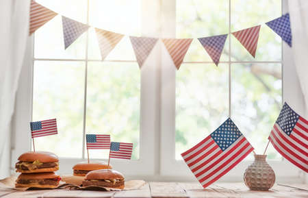Photo for Patriotic holiday. USA are celebrate 4th of July. Top view with American flag on the table. - Royalty Free Image