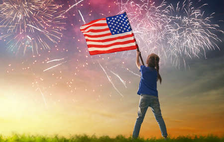 Photo pour Patriotic holiday. Happy kid, cute little child girl with American flag. USA celebrate 4th of July. - image libre de droit