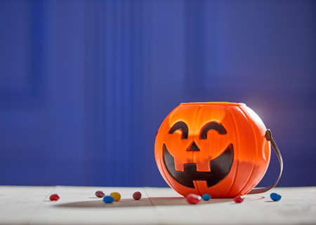 Photo for Happy halloween! Pumpkin with candy in the home.  - Royalty Free Image