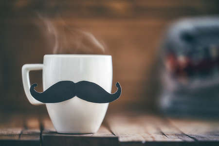 Photo pour Happy father's day! Cup of coffee on background of wooden table. - image libre de droit