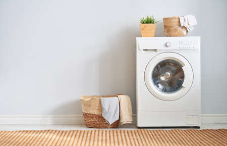 Photo for Interior of a real laundry room with a washing machine at home - Royalty Free Image